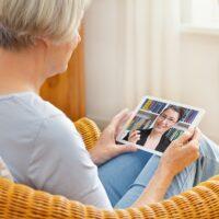 teletherapy senior woman tablet computer