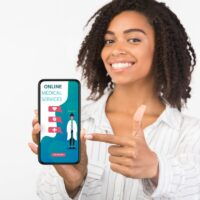 Girl holding phone with online medical services on screen