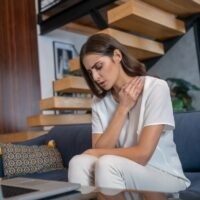 Frustrated woman getting a psychological support remotely