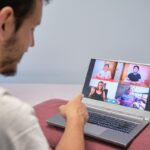 Man pointing at a person on a videocall therapy session. Distance therapy concept.
