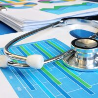 Stethoscope on a financial report. Business analysis and audit.